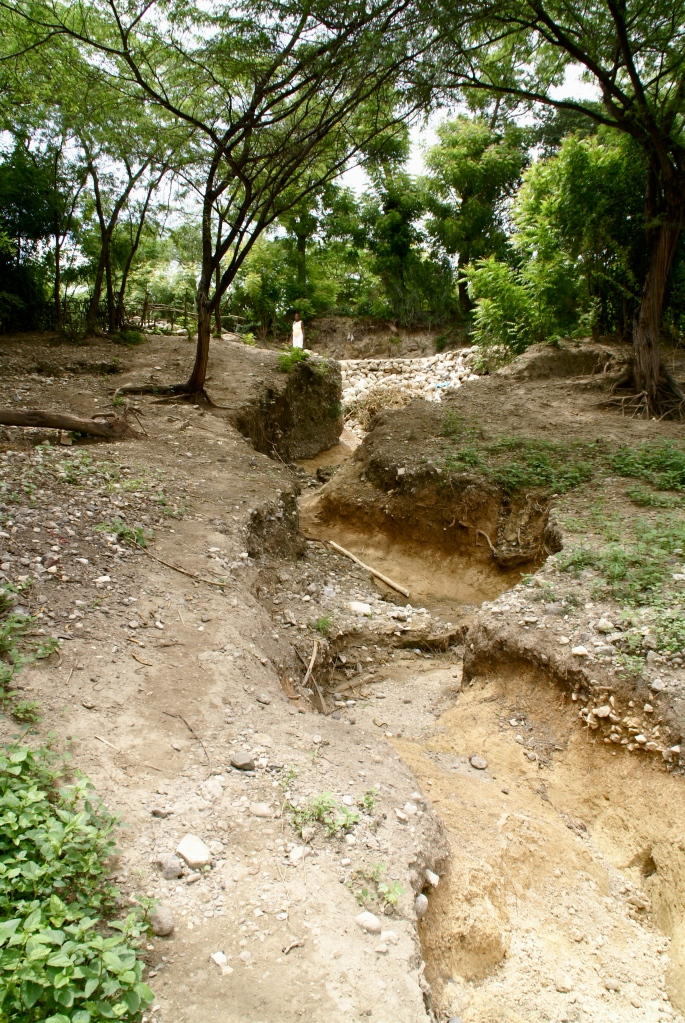 Once a road, now a river for constant floods until they can repair it permanently