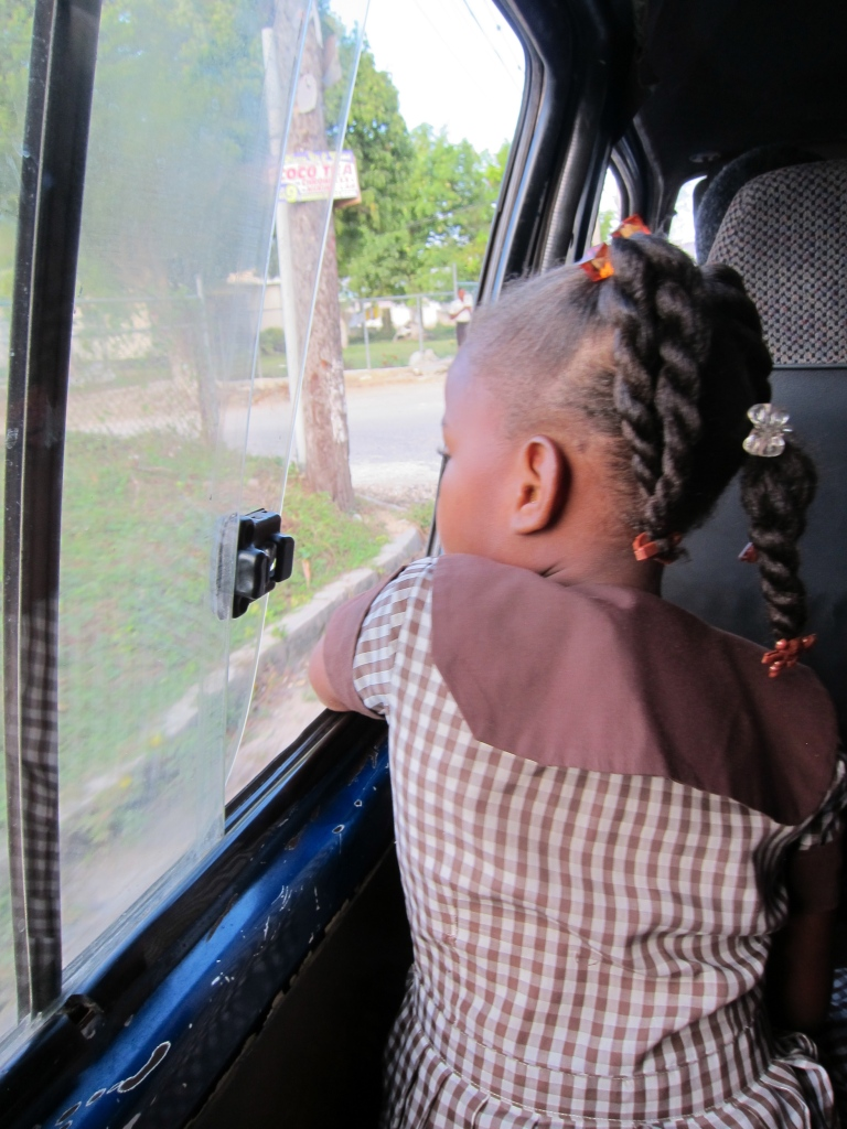 "Looking to the future. This girl is acting as a ""loader or ducta"" man on the bus to town."
