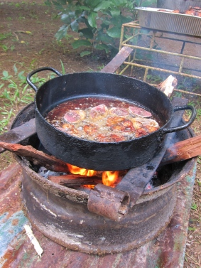 One of the many makeshift stoves with frying fish in it