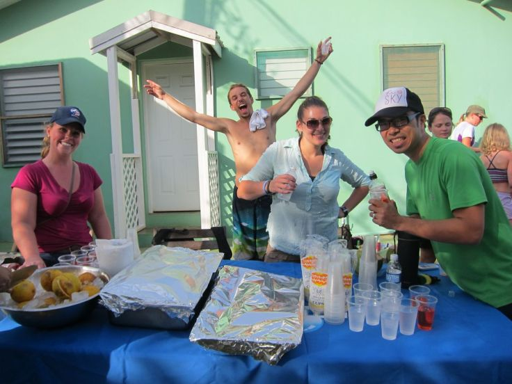 Peace Corps volunteers helping at a water station