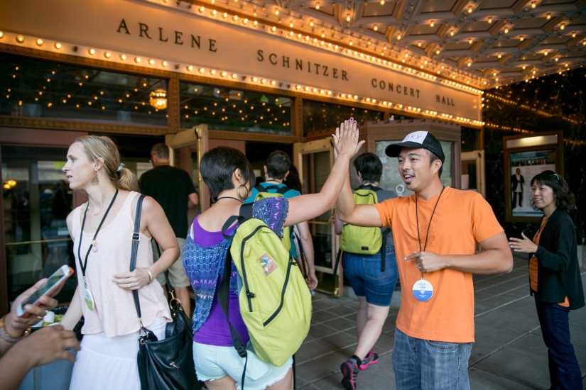 Welcoming participants with high fives. Lots of high fives - Photo Credit: Armosa Studio