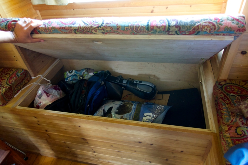 extra storage underneath the bench cushions
